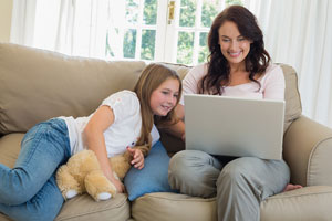 Mom at home with child getting education via distance education